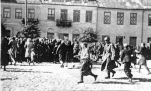 Jews escape from the Nazis in Plonsk ---  running when the Germans wanted to transport them to the Camps.