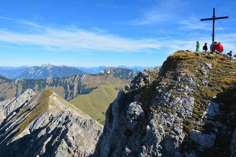 trekkers at a peak in the Karwendel Range