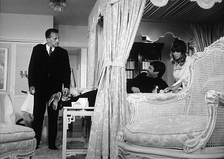 George C Scott watching Richard Chamberlain on the bed with Julie Christie in a scene from Petulia