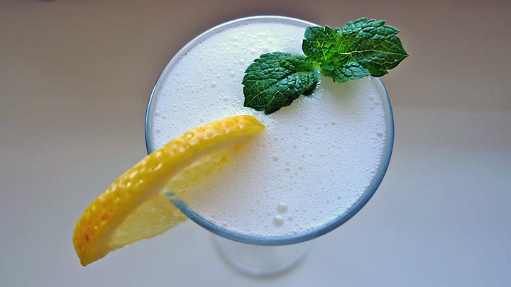 sgroppino garnished with a lemon wedge and some mint leaves