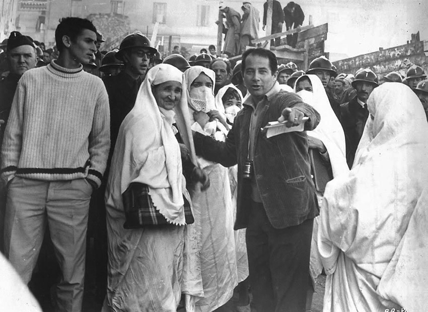 Gillo Pontecorvo directing a scene in the movie The Battle of Algiers