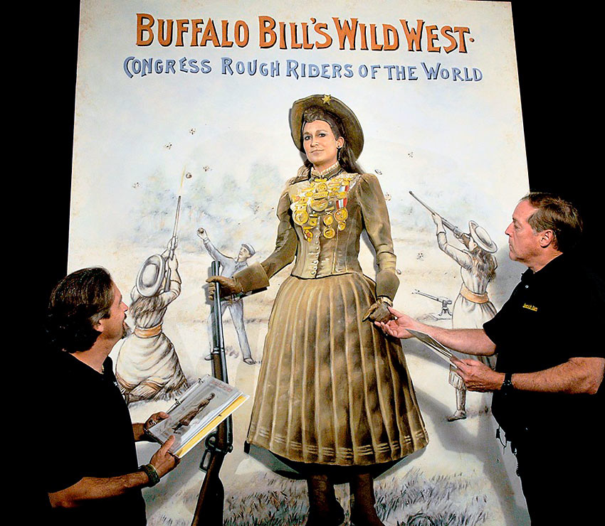 recreation of an Annie Oakley poster with a live motionless model