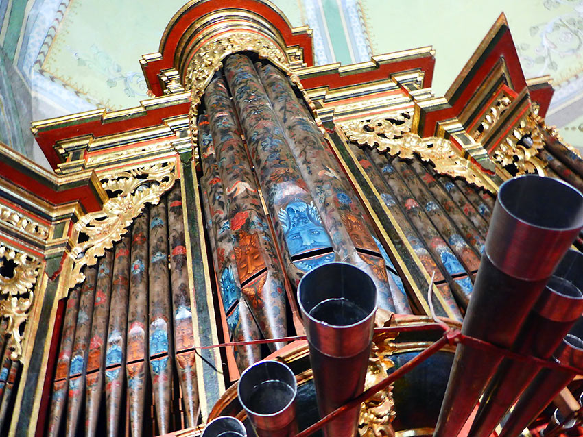 church organ with art work