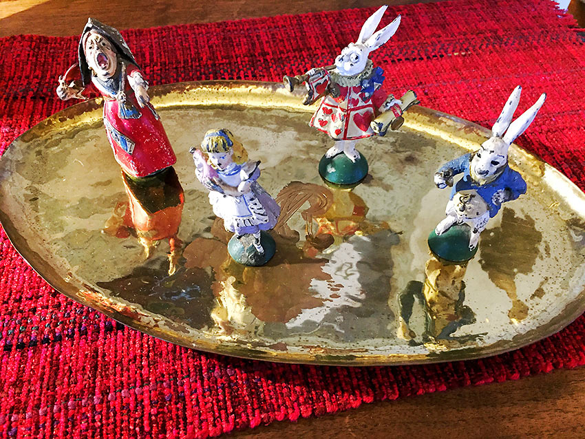 figurines on a tray