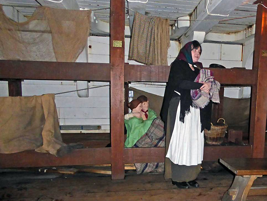 costumed enactor talks about living conditions during the crossing to America