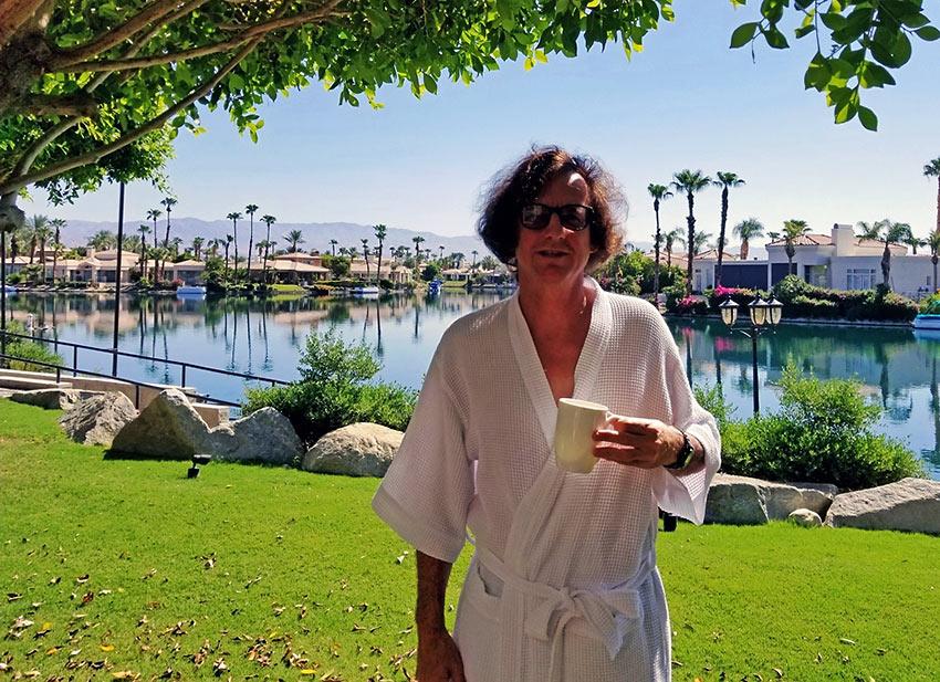 the writer enjoying morning coffee by Lake La Quinta