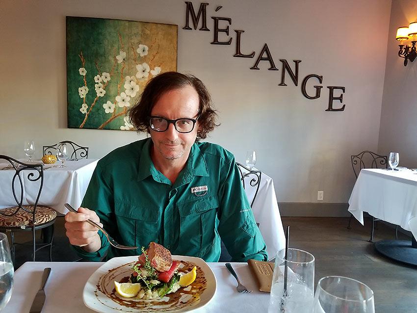 the writer enjoying a dish at the Melange