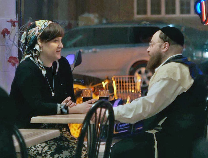 Menashe meets a woman recommended by the local matchmaker