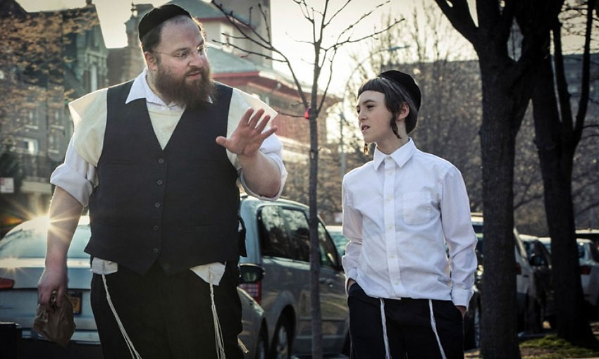 Menashe with his son Rieven played by Ruben Niborski