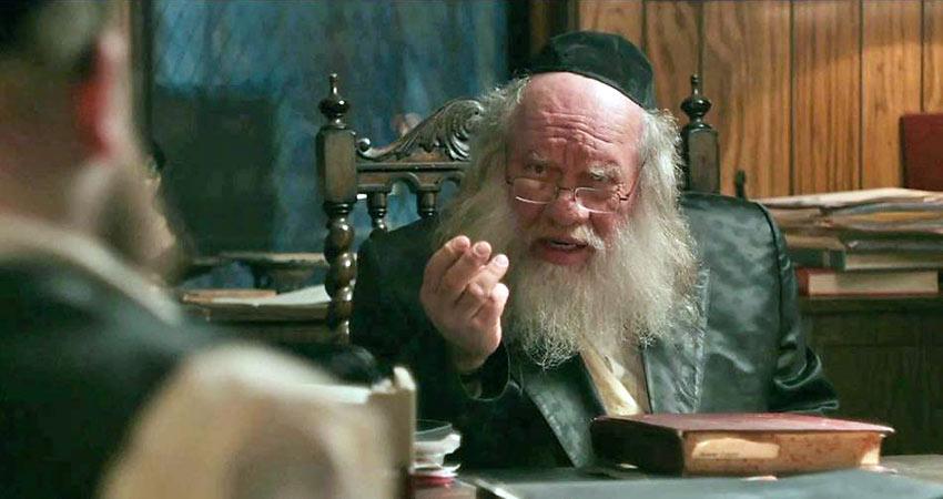 Menashe played by Menashe Lustig with his rabbi