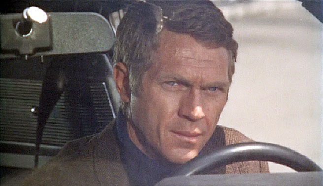 Steve McQueen inside a car in Bullitt