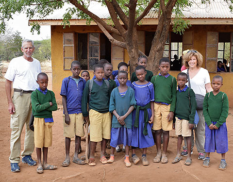 writer with children at a school near Arusha, Tanzania