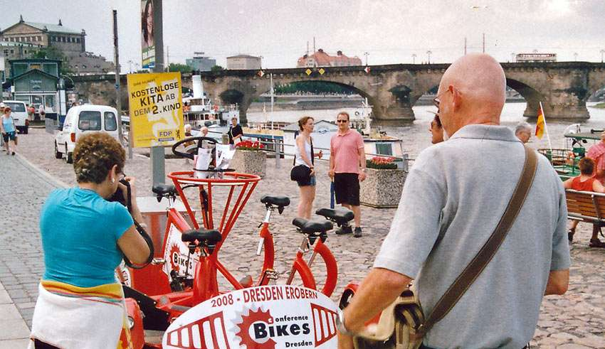 travel writers fascinated by a bicycle for 7, Dresden, Germany