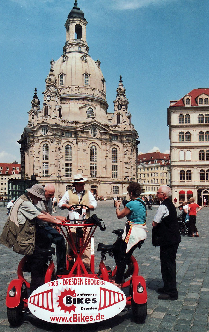 Bicycle for 7 with the Dresden Frauenkirche in the background