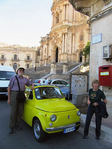 writer with vintage iconic Fiat 500