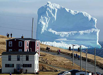 "the first iceberg of the season passes the South Shore, also known as ""Iceberg Alley"" near Ferryland, Newfoundland"