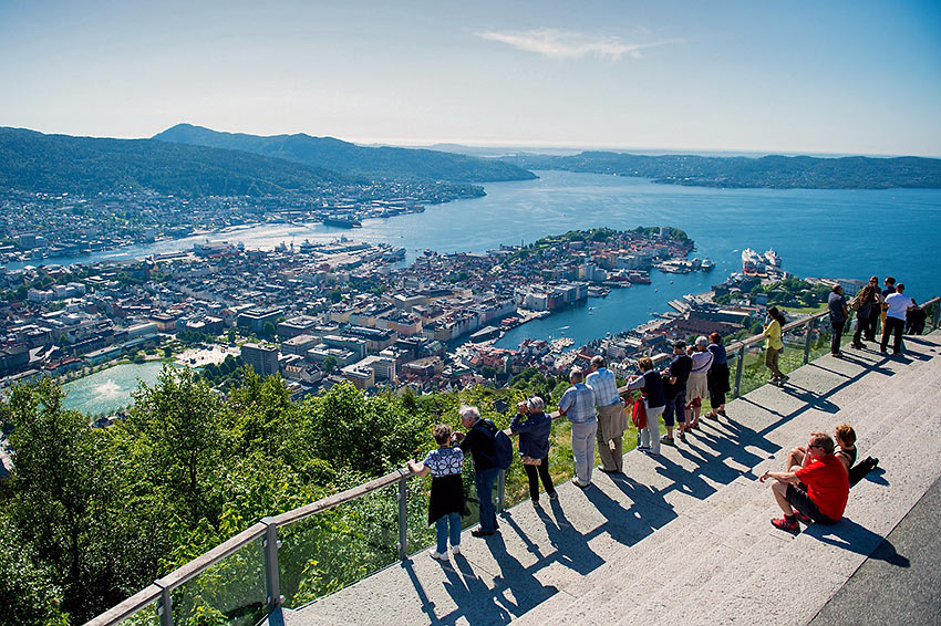 visitors enjoying a view of Bergen from a vantage point
