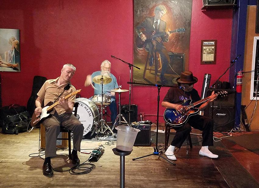 Larry Teves aka Chickenbone Slim, Bruce Stewart, and Tomcat performing