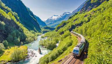 Flam Railway train running along the Flamsdalen Valley