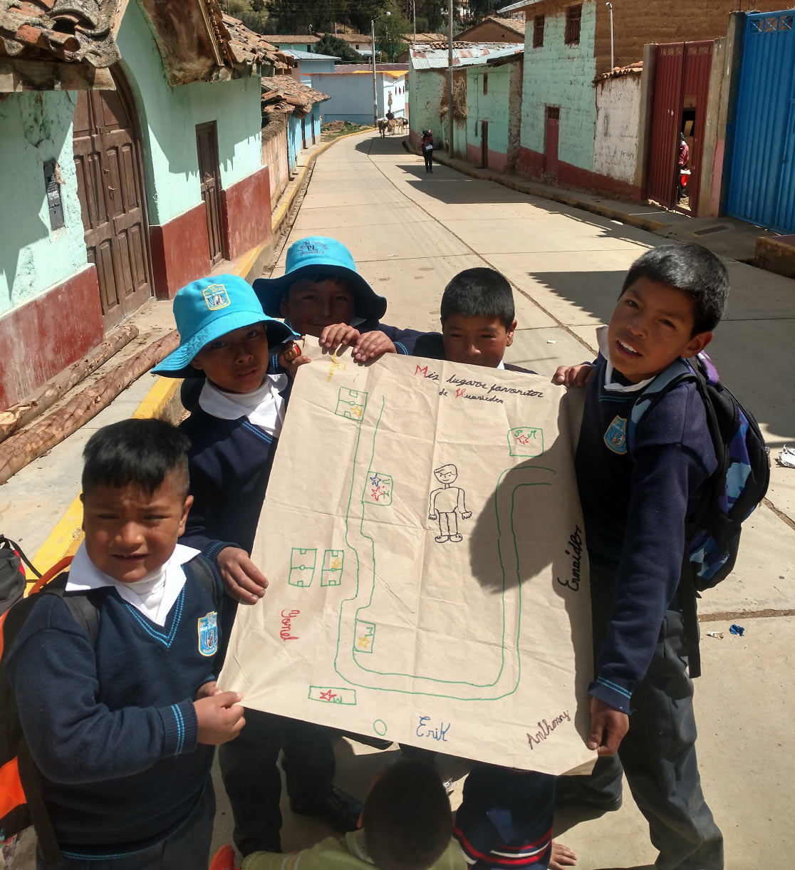students from Premaria help the writer prepare a community map