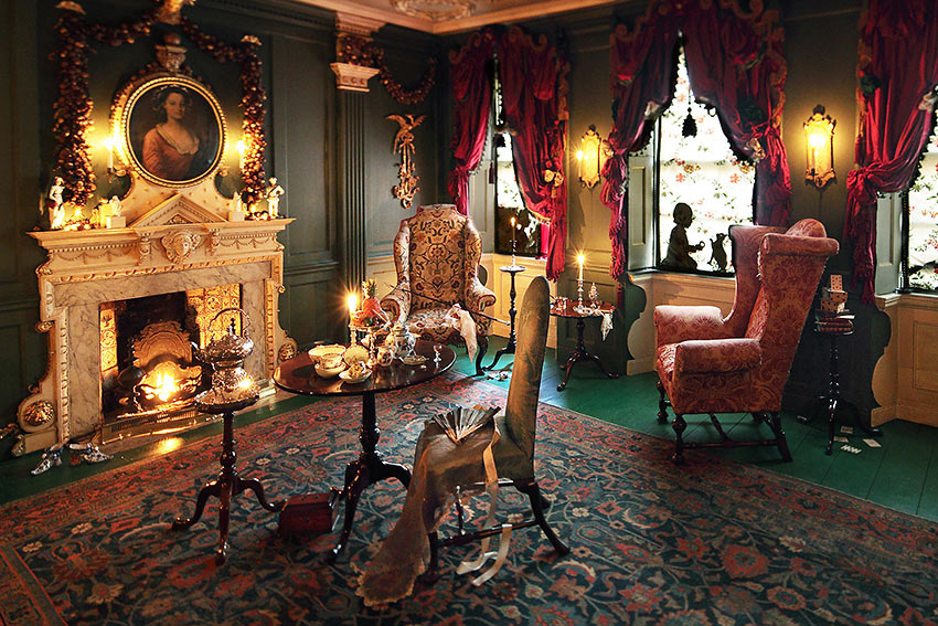 The Living Room filled with original, true-to-the 1800 period furniture and a real fire in the hearth