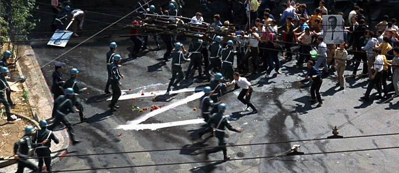 a clash between demonstrators and police: a scene from the movie Z