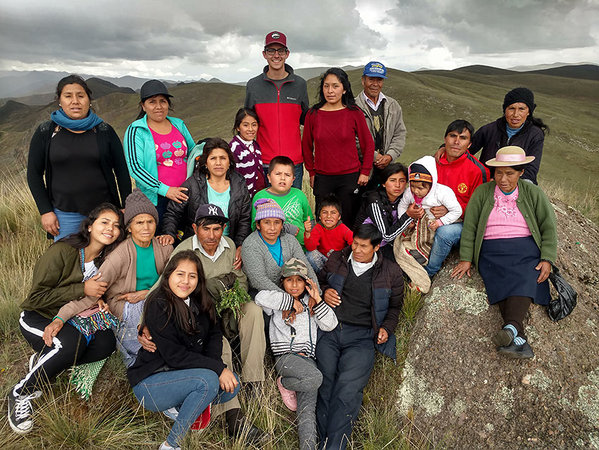 author with extended family in Huaricolca, Peru