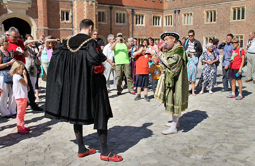 docents at the Hampton Court Palace courtyard offer colorful history