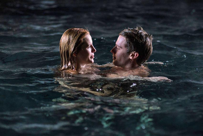 Bella Thorne and Patrick Schwarzenegger in a romantic moonlight swim