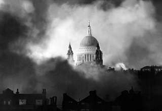 St Pauls Cathedral surrounded by fire and smoke after a Luftwaffe bombing raid in World War 2