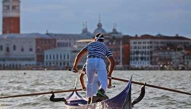 rowers on a gondola, Venice