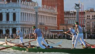 rowers and gondolas at a regatta, Venice