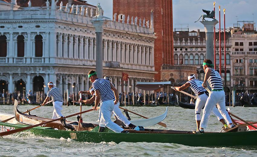 rowers and gondolas at a regatta, Venice