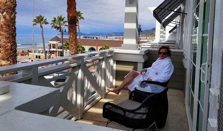 the writer enjoying a view of the Pacific Ocean from his room at the Inn at the Pier