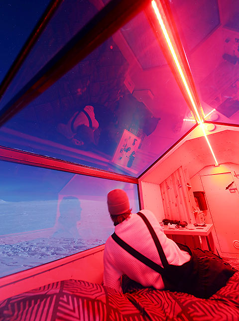 mobile rooms set on skis with a clear Aurora viewing roof