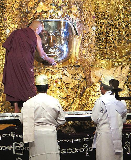 daily cleansing ritual at Maha Muni Pagoda, Mandalay, Myanmar