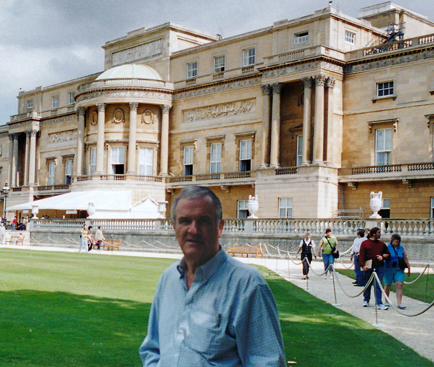 the writer at the back garden of Buckingham Palace