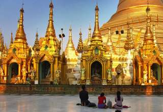 Burmese praying at pagoda