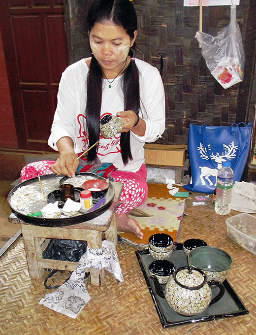 woman making yellow paste from Thanaka bark