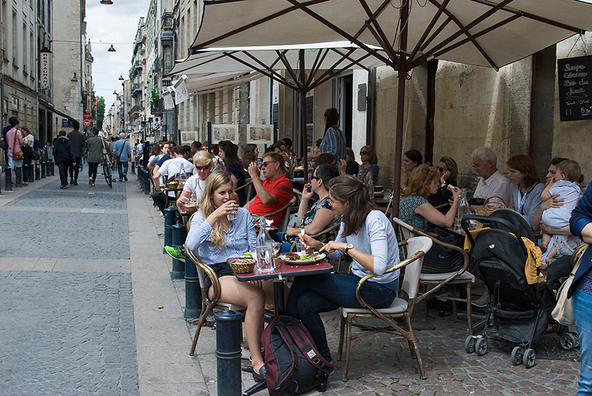 sidewalk tables and restaurants at Bordeaux historic Old Town