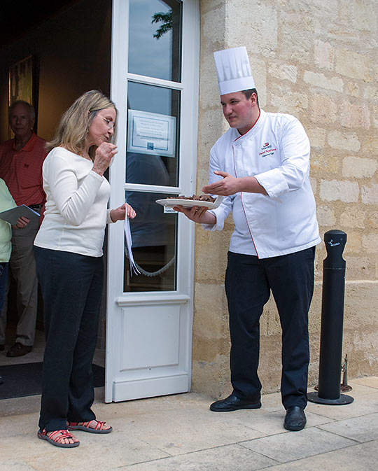 Chef Daniel Papadimas, offering chocolate to a guest at Chateau Kirwan