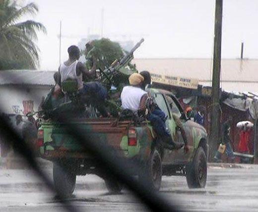 "a ""technical"", a Pickup truck with a mounted machine gun, in Liberia"