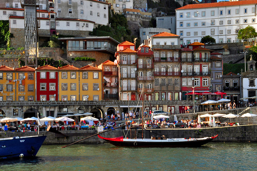 pastel-hue houses, waterfront cafes and bars at the Ribeira neighborhood, Porto