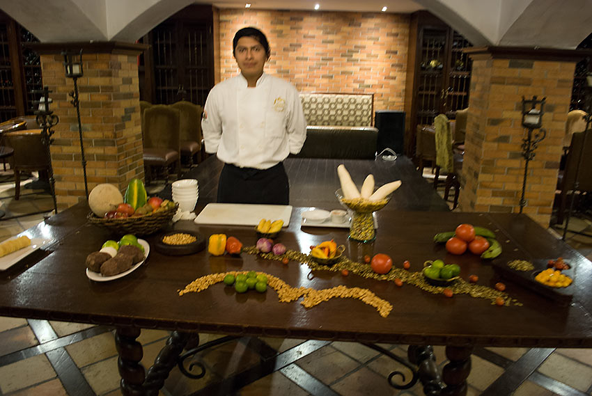 Assistant Che, Christian Pilajo, presenting a cooking demonstration of classic Ecuadorian cuisine at Plaza Grande Hotel, Quito