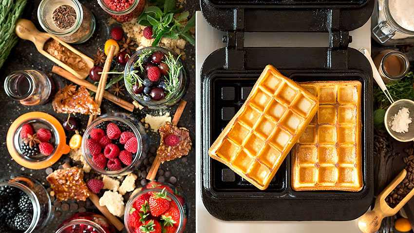 a breakfast tray with waffles at the Atlantic Kempinski Hotel, Hamburg