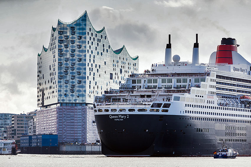 Cunard's Queen Mary 2 docked near the Elbphilharmonie, Hamburg