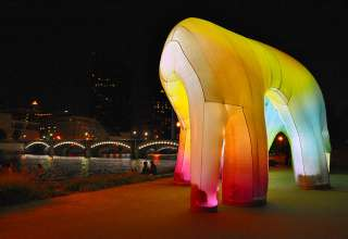 "the inflatable sculpture ""Light Cave"" at Ah-Nab-Awen Park on the Grand River, at night"