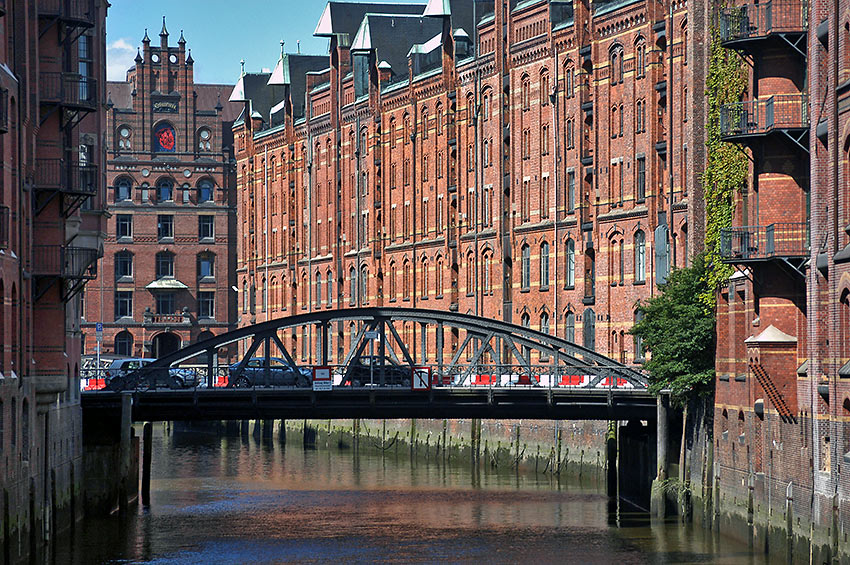 canal bridge and picturesque, restored warehouses at the Speicherstadt district, Hamburg
