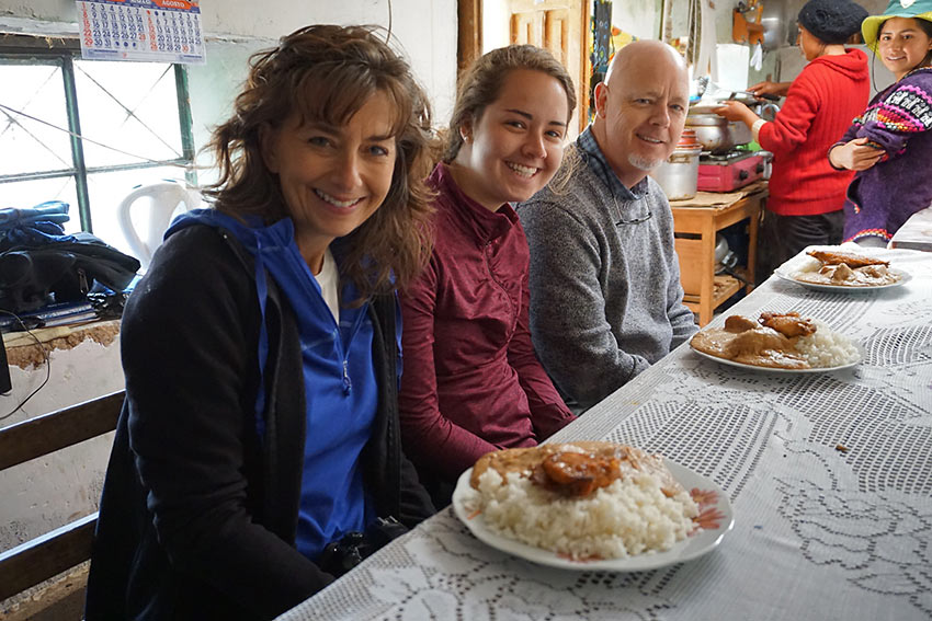 author's family trying cuy con maní (guinea pig with peanut sauce) for lunch