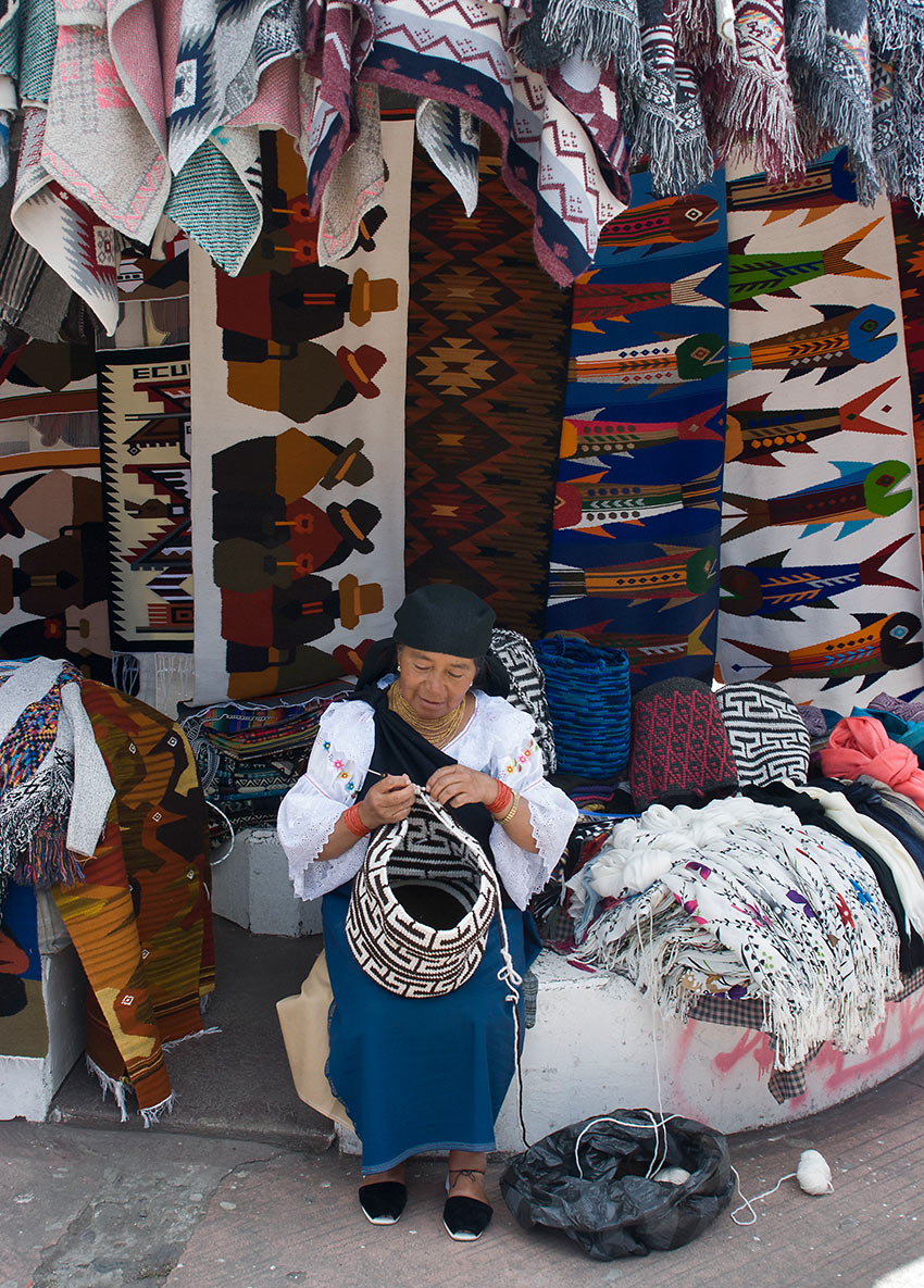 a weaver at her store, Otavalo Craft Market, Quito